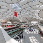 BEIJING, CHINA - AUGUST 30: (Image taken with fisheye lens) Simulated passengers participate in the fifth comprehensive drill at Beijing Daxing International Airport on August 30, 2019 in Beijing, China. 8,868 simulated passengers and 140 flights participate in the fifth comprehensive drill at Beijing Daxing International Airport on August 30. The airport is scheduled to operate at the end of September in Beijing. (Photo by Chen Xiao/VCG via Getty Images)